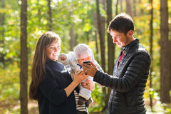 Portrait of a happy young couple playing with their cute newborn baby Royalty Free Stock Images