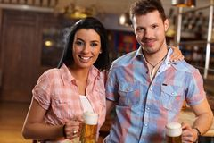 Portrait of happy young couple in pub Royalty Free Stock Images