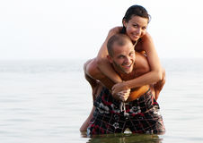 Portrait of a happy young couple in sea Stock Photo