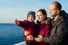 Portrait of happy young couple with son in park Royalty Free Stock Photo