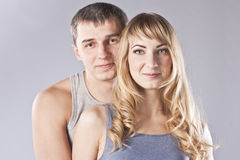 Portrait of a happy young couple. Studio Royalty Free Stock Images