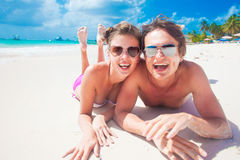 Portrait of happy young couple with suncream dots Royalty Free Stock Images