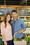 Portrait of a happy young couple in supermarket Royalty Free Stock Photography