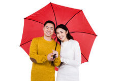 Portrait of happy young couple under umbrella Royalty Free Stock Image