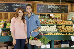 Portrait of a happy young couple in vegetable market Royalty Free Stock Photography