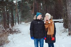 portrait of happy young couple walking in winter snowy forest Stock Images