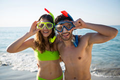 Portrait of happy young couple wearing scuba masks at beach Royalty Free Stock Photo