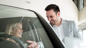 Portrait of happy customer buying new car. Portrait of happy young customer buying new car royalty free stock photography