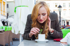 Portrait of happy young cute elegant woman sitting outdoor in a Stock Photography