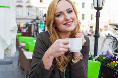 Portrait of happy young cute elegant woman sitting outdoor in a Royalty Free Stock Images