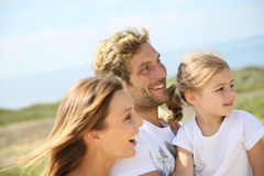 Portrait of happy young family admiring beautiful nature Stock Photo