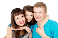 Portrait of happy young family with a child girl Stock Photo