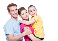 Portrait of the happy young family with child. Stock Photography