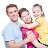 Portrait of the happy young family with child. Stock Photo