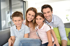 Portrait of happy young family with children at home Stock Photos
