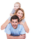 Portrait of happy young family with children. Portrait of happy young family with children lying on the floor - isolated on white background stock photo
