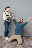 Portrait of a happy young family expecting child and celebrating Royalty Free Stock Images