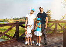 Portrait of a happy young family in golf club Stock Photography