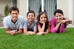 Portrait of happy young family lying on grass Stock Photography
