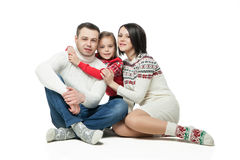Portrait of happy young family sitting together Royalty Free Stock Image