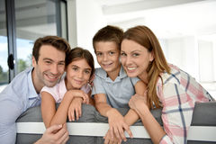 Portrait of happy young family spending time together Royalty Free Stock Photography
