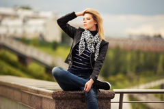 Portrait of happy young fashion woman outdoor Stock Photos