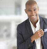 Happy businessman smiling. Portrait of a happy young fashionable businessman smiling with copy space Stock Image