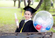Portrait of happy young female graduates in academic dress Royalty Free Stock Photo