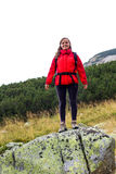 Portrait of happy young female hiker smiling Stock Photos
