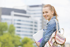 Portrait of happy young female student at college campus Stock Photography