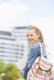 Portrait of happy young female student at college campus Stock Image