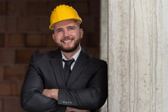 Portrait Of Happy Young Foreman With Hard Hat Royalty Free Stock Photo