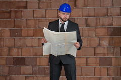 Portrait Of Happy Young Foreman With Hard Hat Royalty Free Stock Image