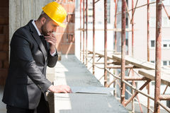 Portrait Of Happy Young Foreman With Hard Hat Royalty Free Stock Photography