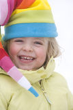 Portrait of happy young girl in colorful winter hat stock photo