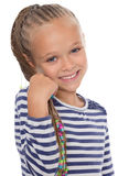 Portrait of a happy young girl. With dreadlocks. The girl is six years old Stock Photography