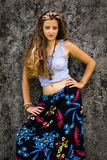 Portrait of a happy young Girl and dressed floral maxi skirt with top royalty free stock image
