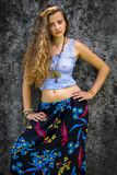 Portrait of a happy young Girl and dressed floral maxi skirt with top royalty free stock images
