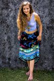 Portrait of a happy young Girl and dressed floral maxi skirt with top stock photo