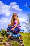 Portrait of a happy young Girl and dressed floral maxi skirt with top stock photography
