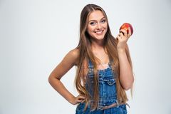 Portrait of a happy young girl holding apple Stock Photos
