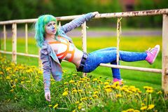 Portrait happy young girl on holi color festival hangs on an old fence Stock Images