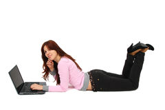 Portrait of a happy young girl with laptop Stock Image
