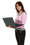 Portrait of a happy young girl with laptop Royalty Free Stock Photos