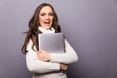 Portrait of a happy young girl with laptop computer Royalty Free Stock Photos