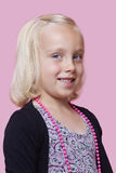 Portrait of a happy young girl over pink background Royalty Free Stock Photography