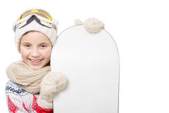 Portrait of a happy young girl snowboarding Stock Photo