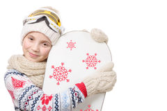 Portrait of a happy young girl snowboarding Stock Photos