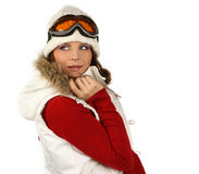 Portrait of a happy young girl snowboarding.  Royalty Free Stock Image