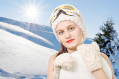 Portrait of a happy young girl snowboarding with goggles Stock Photos